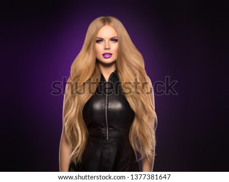 Beautiful blonde hair woman long healthy hairstyle purple color lipstick #1377381647