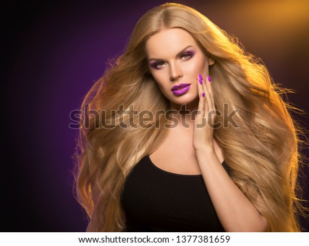 Beautiful blonde hair woman long healthy hairstyle purple color lipstick #1377381659