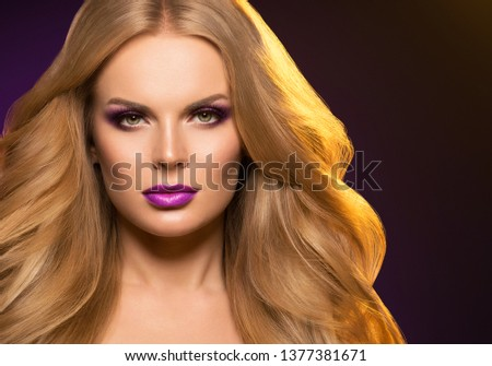 Beautiful blonde hair woman long healthy hairstyle purple color lipstick #1377381671