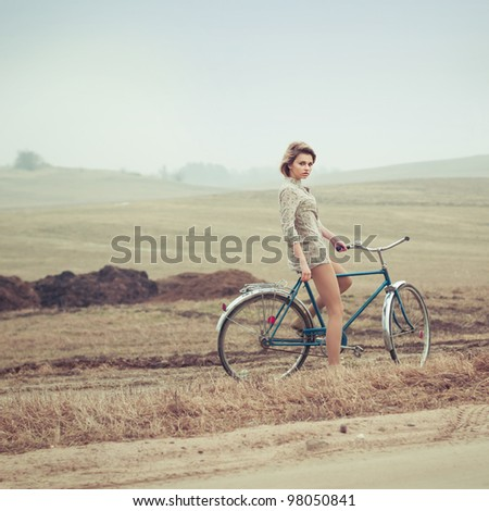 beautiful blonde in a dress on a bicycle