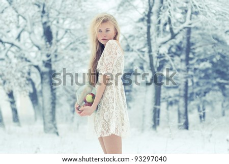 beautiful blonde in the woods in winter