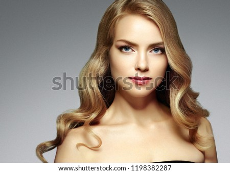 Beautiful blonde long hair woman curly  healthy beauty hairstyle female portrait #1198382287