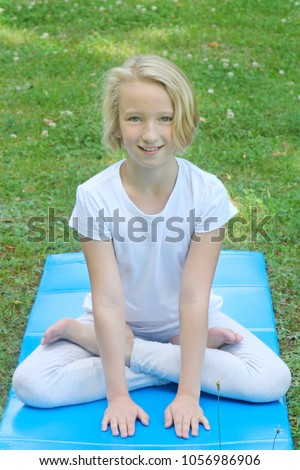 stock-photo-beautiful-blonde-preteen-girl-in-light-clothing-practicing-yoga-on-a-mat-in-the-park-1056986906 The Bridal Market in Bulgaria