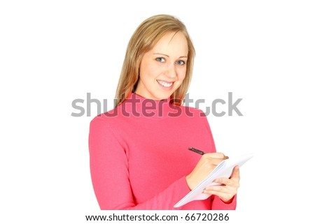 Beautiful blonde student taking notes on a paper pad with a pen