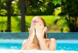 Beautiful blonde swimming in the pool