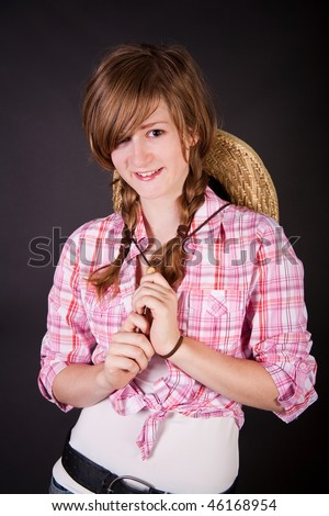 stock photo : Beautiful blonde teen girl in western clothes