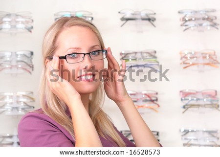 beautiful blonde tries on glasses