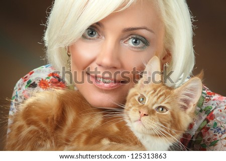 beautiful blonde with a red cat