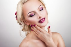 beautiful blonde with beautiful make-up and angling hands