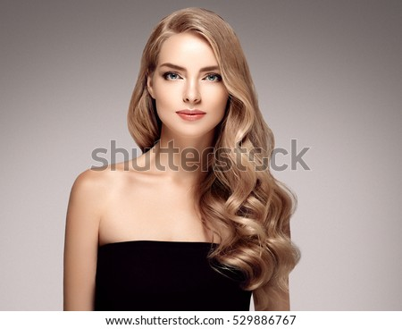 beautiful Blonde Woman Beauty Model Girl with perfect makeup and hairstyle