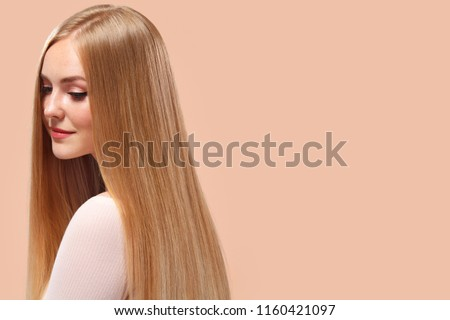 Beautiful Blonde Woman Beauty Model Girl with perfect makeup and long straight hair on light copyspace #1160421097