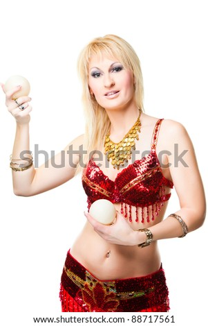 beautiful blonde woman bellydancer in red on isoltared white