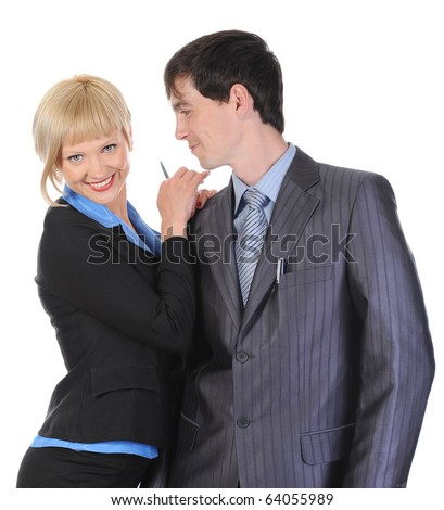 Beautiful blonde woman hugging a man in the suit. Isolated on white background