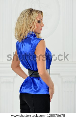 Beautiful blonde  woman in elegant blue suit