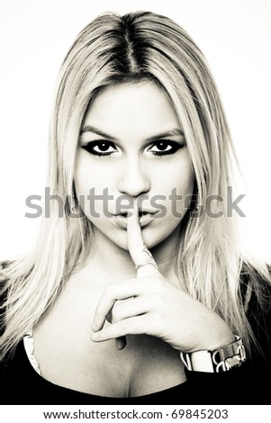 Beautiful Blonde Woman Making Silence Gesture