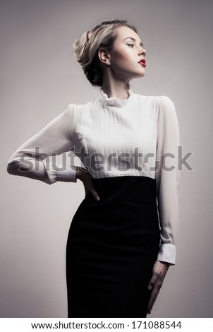 Stock Photo Beautiful Blonde Woman. Retro Fashion Image.