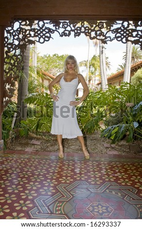 Beautiful Blonde Woman standing in a Spanish Courtyard