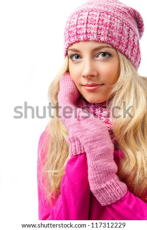 beautiful blonde woman wearing knitwear over white background