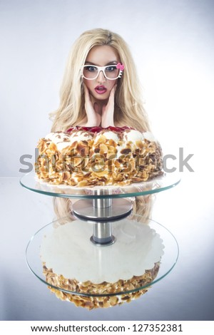 Beautiful blonde woman with a cake. Sweet sexy lady with glasses