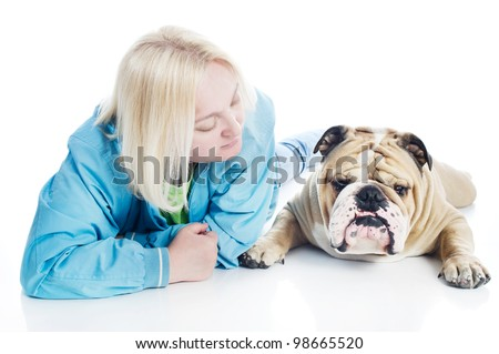 Beautiful blonde woman with a dog english bulldog isolated - stock photo
