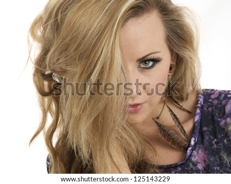 Beautiful blonde woman with hair covering one eye