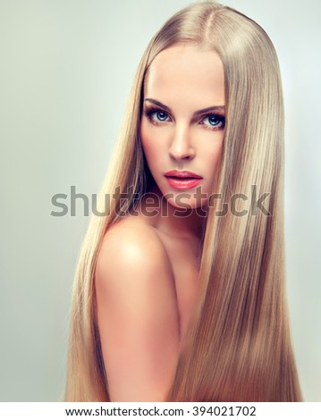 Beautiful blonde woman with long  straight  healthy and shiny hair.  #394021702