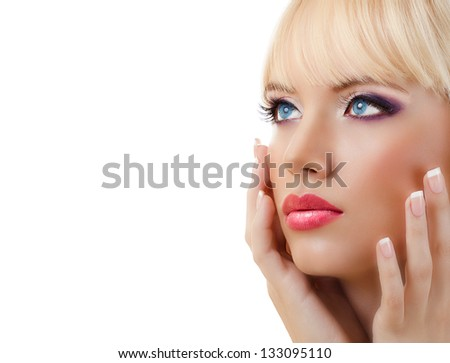 Beautiful blonde woman with manicure and purple makeup on white background