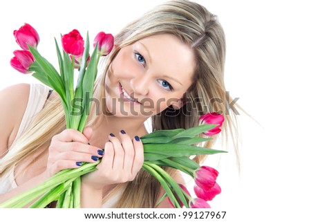 Beautiful blonde woman with red tulips bouquet of flowers smiling isolated on white background