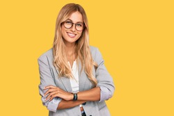 Beautiful blonde young woman wearing business clothes happy face smiling with crossed arms looking at the camera. positive person.