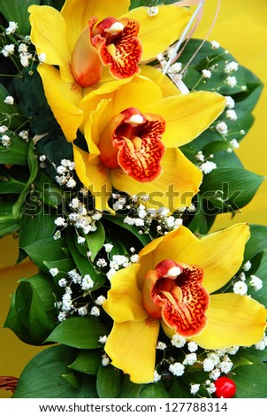 beautiful blooming flowers bouquet with three yellow orchids