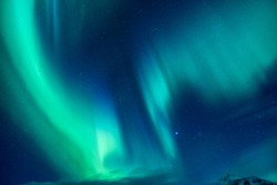 Beautiful blue and green Northern light, abstract natural background, magic paranormal light in the night starry sky, beautiful nature of Iceland