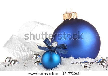 beautiful blue Christmas balls on snow, isolated on white