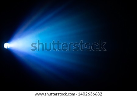 beautiful blue color spotlight wide lens projector with light beam for film movie and cinema at night . abstract smoke texture . screening for multimedia . black background . #1402636682