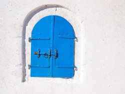 Beautiful blue colored wooden window in a house in Langada a village of Amorgos island in Greece