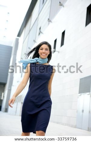Beautiful blue dress stewardess walking to convention center