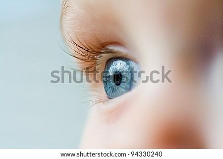 Stock Photo Beautiful blue eye macro shot