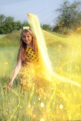 Beautiful blue-eyed, blonde with long hair like a sunny princess. With a radiant crown on her head and radiating warm light, yellow magical butterflies fly to her. Sun, a bright bright day, happiness