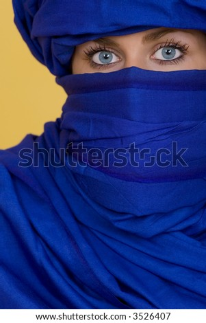 Beautiful blue eyes look out from behind an indigo veil