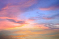 Beautiful blue orange sky with clouds background.