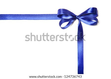Beautiful blue ribbon with a bow from fabric. Isolated on a white background