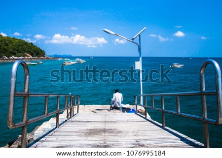 Beautiful blue sea and  speed boats near an island  #1076995184