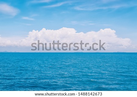 Beautiful blue seascape with white clouds
