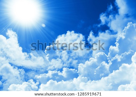 Beautiful blue sky white cloud and sunshine. Religion concept heavenly background. Divine heavenly light. Sunny day. Peaceful nature background #1285919671