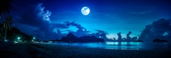 Beautiful blue sky with cloud and bright full moon on seascape at night. Serenity background, outdoors at nighttime. The moon taken with my own camera.