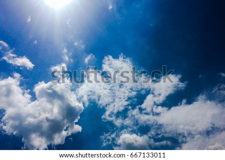 beautiful blue sky with clouds background.Sky clouds.Sky with clouds weather nature cloud blue.Blue sky with clouds and sun. #667133011