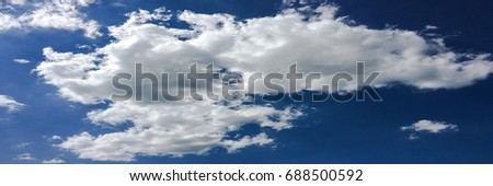 beautiful blue sky with clouds background.Sky clouds.Sky with clouds weather nature cloud blue.Blue sky with clouds and sun #688500592