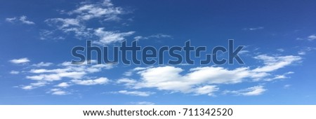 beautiful blue sky with clouds background.Sky clouds.Sky with clouds weather nature cloud blue.Blue sky with clouds and sun. #711342520