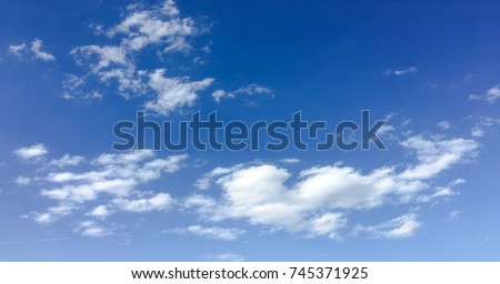 beautiful blue sky with clouds background.Sky clouds.Sky with clouds weather nature cloud blue.Blue sky with clouds and sun #745371925