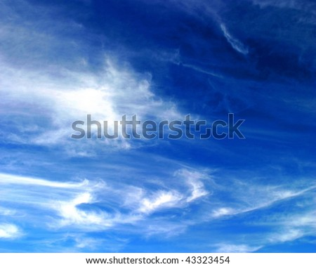 Beautiful blue sky with soft white clouds