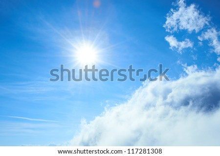 Beautiful blue sky with sun and clouds